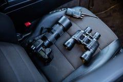 Elektronisk utrustning på bilsätet Arkivbild