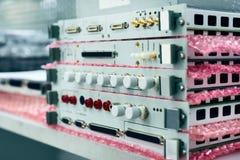 Elektroniska enheter och elektroniska kort som staplas i en bunt Fotografering för Bildbyråer