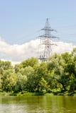 Elektryczność pilonu zakończenia duduś on jezioro Fotografia Royalty Free