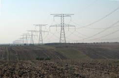 Elektryczność przewiezeni pilony Zdjęcia Stock