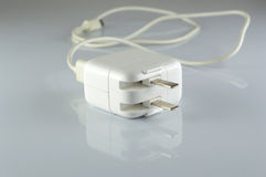 Elektryczny adaptator USB port na szarym tle Fotografia Royalty Free