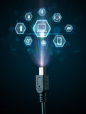 Elektryczny kabel z multimedialnymi ikonami Obrazy Royalty Free