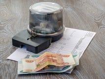 Elektryczny metr, pieniądze, czek Zdjęcia Stock