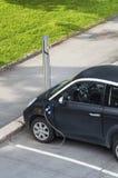 Elektryczny samochód czopujący wewnątrz elektryczność fotografia stock