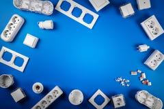Elektryczny wyposażenie na błękitnym tle z kopii przestrzenią zdjęcie stock