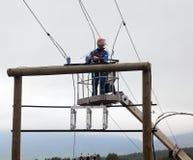Elektryk pracuje przy władza przekazu linii budową Obraz Royalty Free