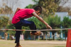 Elemantary  Students Grade 3  take exams High jump. Elemantary Students Grade 3 take exams High jump in school Royalty Free Stock Photography