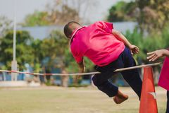 Elemantary students grade 3 take exams high jump. Elemantary students grade 3 take exams high jump in school Stock Photos