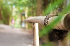An element of a bamboo fence with a pillar joint hold by a twine Stock Photography