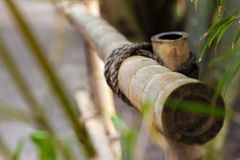 An element of a bamboo fence with a pillar joint hold by a twine Stock Images