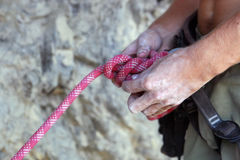 Element climbing safety. A closeup of a person holding part of a safety device or harness similar to what would be used by climbers and rescue workers Royalty Free Stock Photos