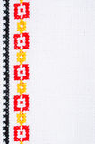 Element Handmade Embroidery By Cross Stitch. Background With Geometric Ornament. Element Handmade Embroidery on Linen by Red, Yellow and Black Cotton Threads Royalty Free Stock Photo
