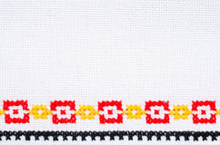 Element Handmade Embroidery By Cross Stitch. Background With Geometric Ornament. Element Handmade Embroidery on Linen by Red, Yellow and Black Cotton Threads Stock Images
