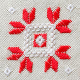 Element handmade embroidery on linen by red and white cotton threads. Background with embroidery. Element handmade embroidery on linen by red and white cotton Stock Photo
