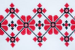 Element Handmade Embroidery on White Linen by Red and Black Cotton Threads. royalty free stock photos