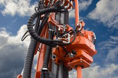 Element of Hydraulic crawler oil drill machine. On blue sky background royalty free stock images