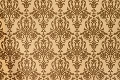 Element of interior decoration of the house. Brown-coffee pattern of Baroque style wallpapers royalty free stock photos