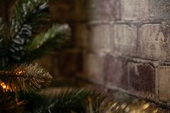 Element of interior decoration of the house. Christmas tree chairs near the brick wall of the corridor royalty free stock photos