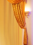 Element of the interior golden curtain Royalty Free Stock Photography