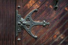 Element of metal sheds on the wooden door Stock Photo