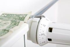 Element och en dollar Pengar på uppvärmningbatteriet royaltyfri foto