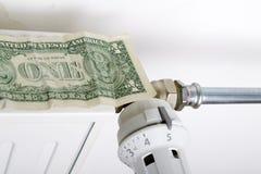 Element och en dollar Pengar på uppvärmningbatteriet royaltyfria foton