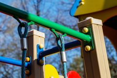 Playground equipment. rope for climbing and riding fixed on the iron bar. Element of the playground close-up. rope for climbing and riding fixed on the iron bar stock images