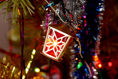 Element of the shining garland a fantastic small lamp on a fir-t Royalty Free Stock Image