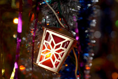 Element of the shining garland a fantastic small lamp on a fir-t Stock Photos