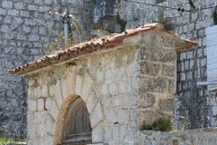 Element of stone fence. Arch over the gate Stock Image
