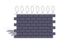 Element of a stone fencing with a barbed wire Stock Photography