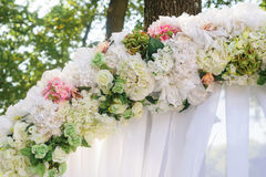 Element wedding arches of white and pink flowers close-up Stock Photo