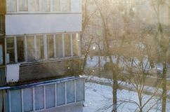 Element of winter nature in the urban landscape. Snowflakes under the sun. House balcony. Element of winter nature in the urban landscape. Snowflakes under the royalty free stock photos