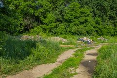 Elemental garbage dump on a green background of nature royalty free stock photo