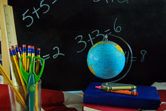 world globe on school books with chalkboard Stock Photo