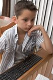 Elementary age (8 years) kid plays computer game Royalty Free Stock Photo