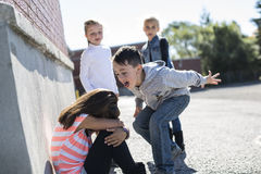 Elementary Age Bullying In Schoolyard Royalty Free Stock Photography