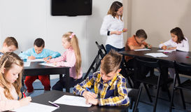 Elementary age children drawing at class in school Royalty Free Stock Photos