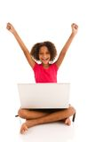 Elementary age girl with laptop and arms raised Royalty Free Stock Photo