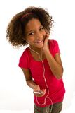 Elementary age girl listening to music Stock Image