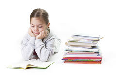 Elementary Age Girl Reading Books Stock Image