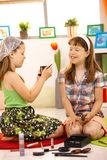 Elementary age girls playing with makeup Royalty Free Stock Image