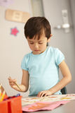 Elementary Age Schoolchild In Art Class Stock Images