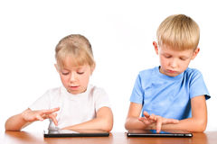 Elementary boy and girl using digital pads Stock Photography