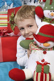 Elementary Boy Holding Stuffed Snowman Royalty Free Stock Image