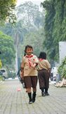 Elementary Boys and Girls Scout Jakarta. Jakarta heat during recess, these elementary kids were allowed to hang around the Indonesia National Gallery Stock Photo