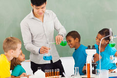 Elementary chemistry experiment. Elementary school chemistry experiment in classroom Royalty Free Stock Images
