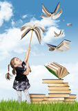 Elementary education creative concept , child girl with flying b Royalty Free Stock Images
