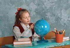Elementary emotional schoolgirl Stock Photography