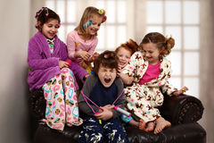 Elementary Girl's Slumber Party Hair Rollers stock photo